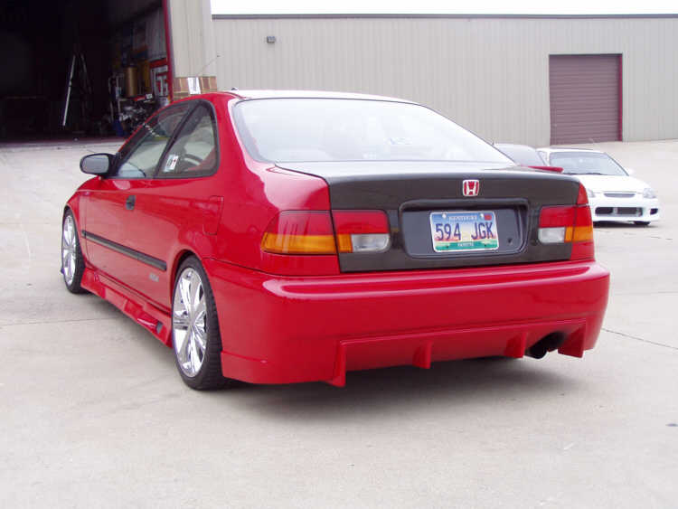 ... Side Skirts Installed After Painting. Rear Bumper Also Installed As  Well As Carbon Fiber Rear